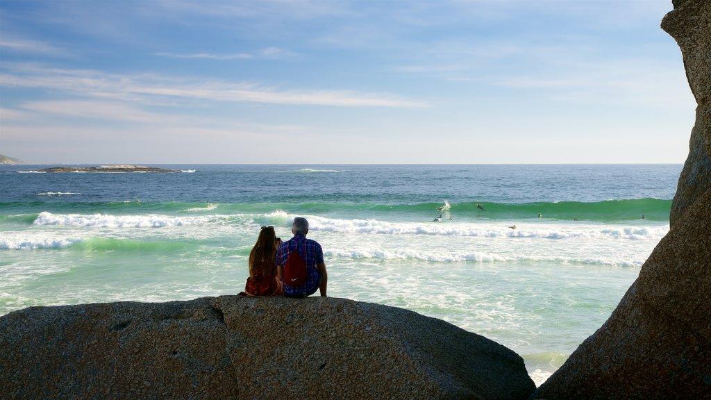 Camps Bay Beach featuring a sandy beach as well as a couple