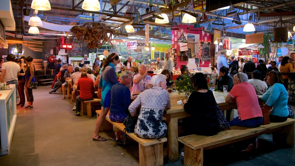 Hout Bay Craft Market which includes interior views and markets as well as a large group of people