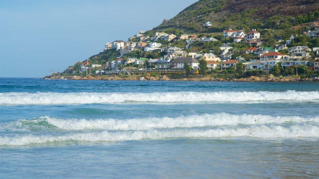 Fish Hoek Beach showing waves and a coastal town