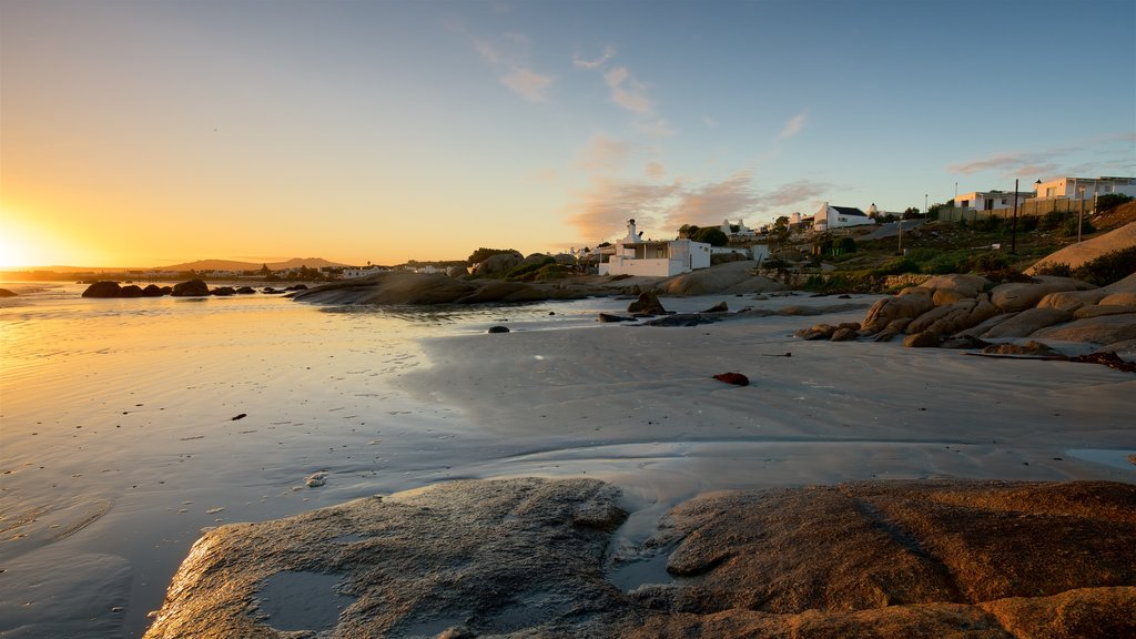Paternoster Beach showing a coastal town, a beach and a sunset