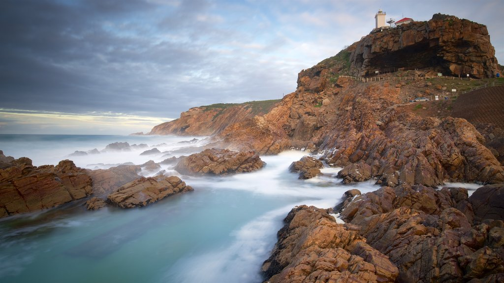 St. Blaize Lighthouse which includes a lighthouse, landscape views and rugged coastline