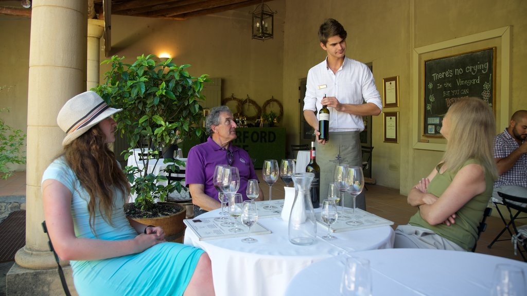 Waterford Wine Estate featuring dining out and drinks or beverages as well as a small group of people