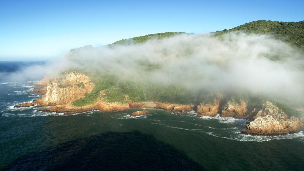 Knysna showing rugged coastline, landscape views and mist or fog