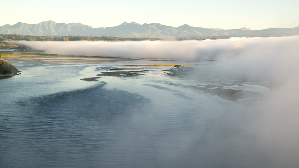 Knysna Lagoon which includes mist or fog, a river or creek and a sunset
