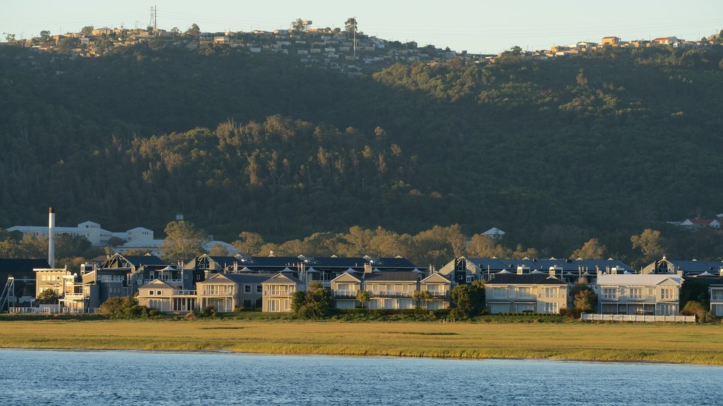 Knysna Lagoon showing a coastal town, tranquil scenes and a sunset