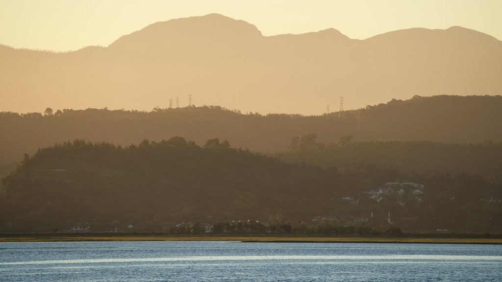 Knysna which includes a coastal town, a sunset and landscape views