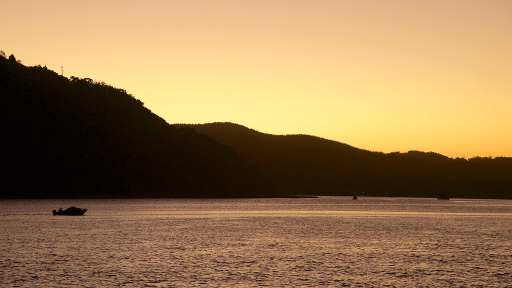 Knysna Lagoon which includes a sunset and general coastal views