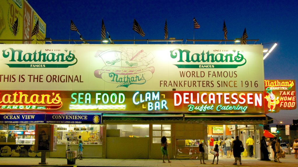 Coney Island showing street scenes, night scenes and signage