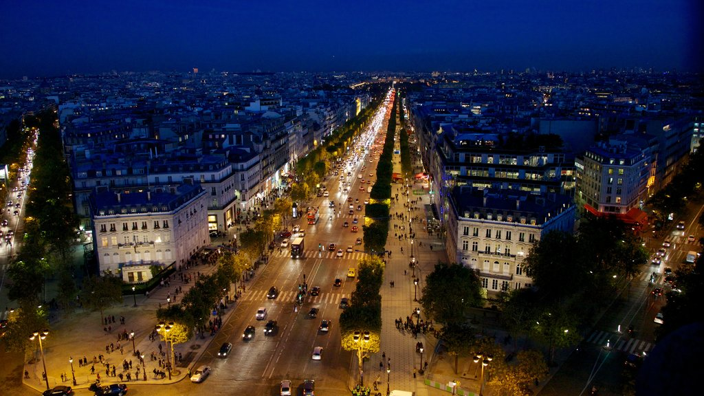 Champs Elysees featuring street scenes, a city and night scenes