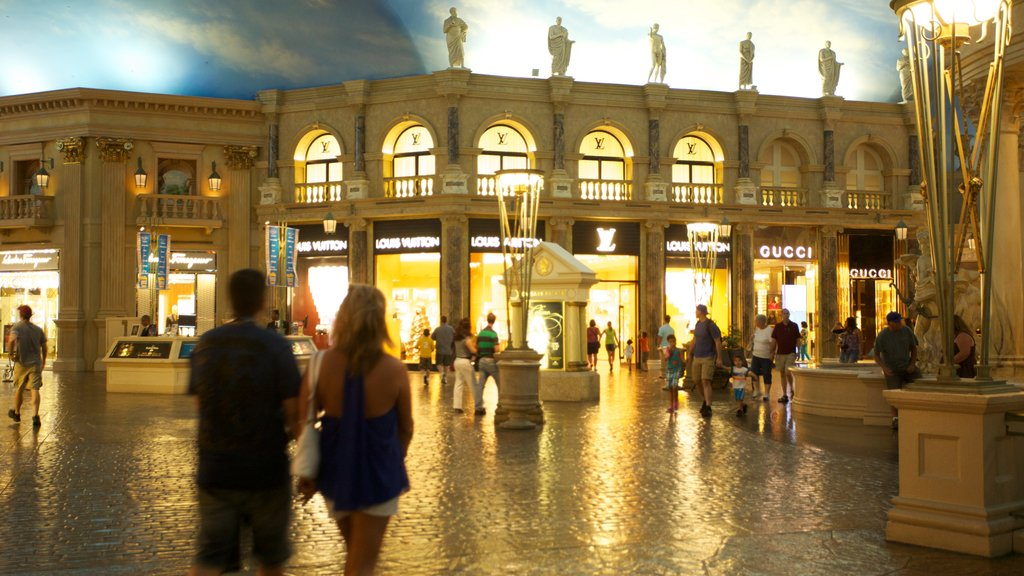 Forum Shops featuring shopping, interior views and a city