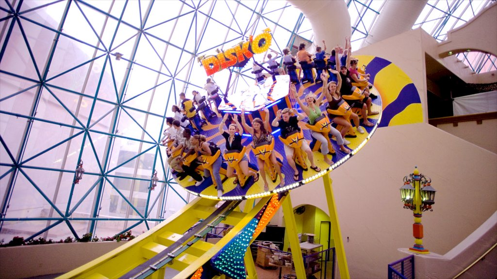 Adventuredome Theme Park featuring interior views and rides as well as a large group of people