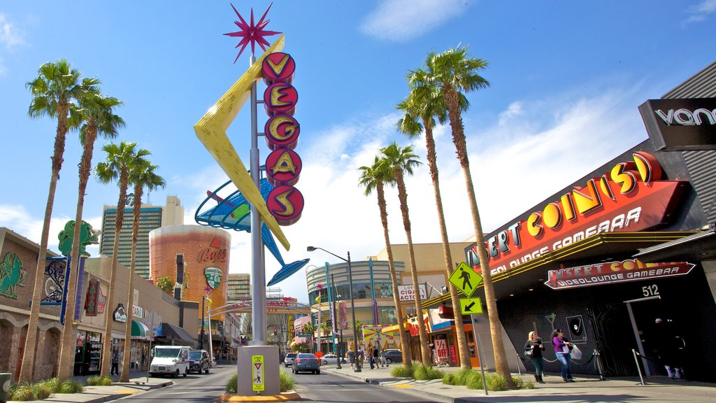 Fremont Street Experience which includes a city, street scenes and signage