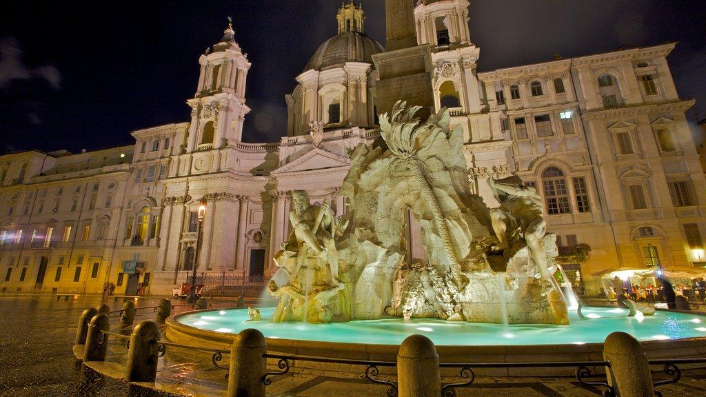 Plaza Navona mostrando escenas nocturnas, un parque o plaza y una ciudad