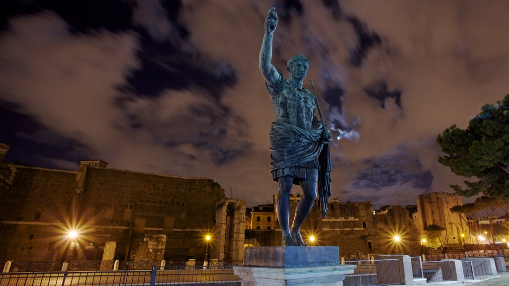 Rome which includes a statue or sculpture, a monument and night scenes