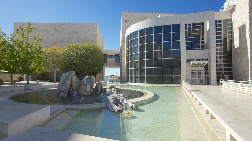 Getty Center showing a city, a fountain and a pond