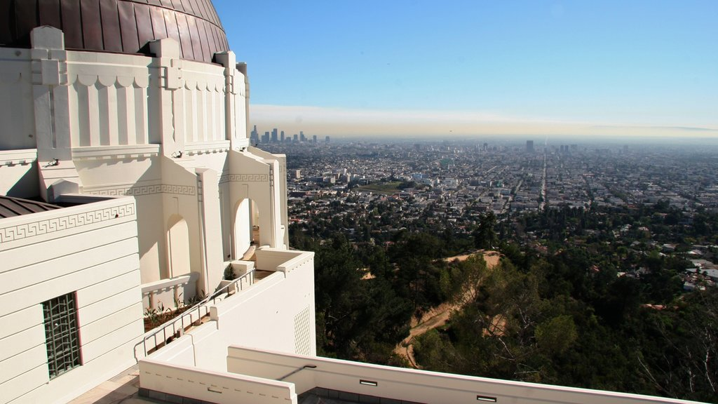 Griffith Observatory featuring a city, an observatory and skyline