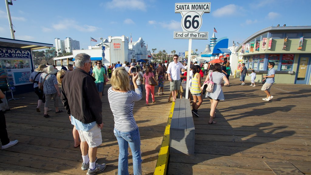 Santa Monica Pier showing street scenes and a city as well as a large group of people