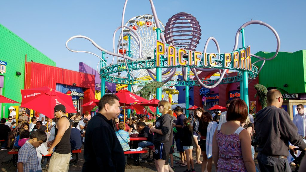 Santa Monica Pier showing street scenes, a city and signage