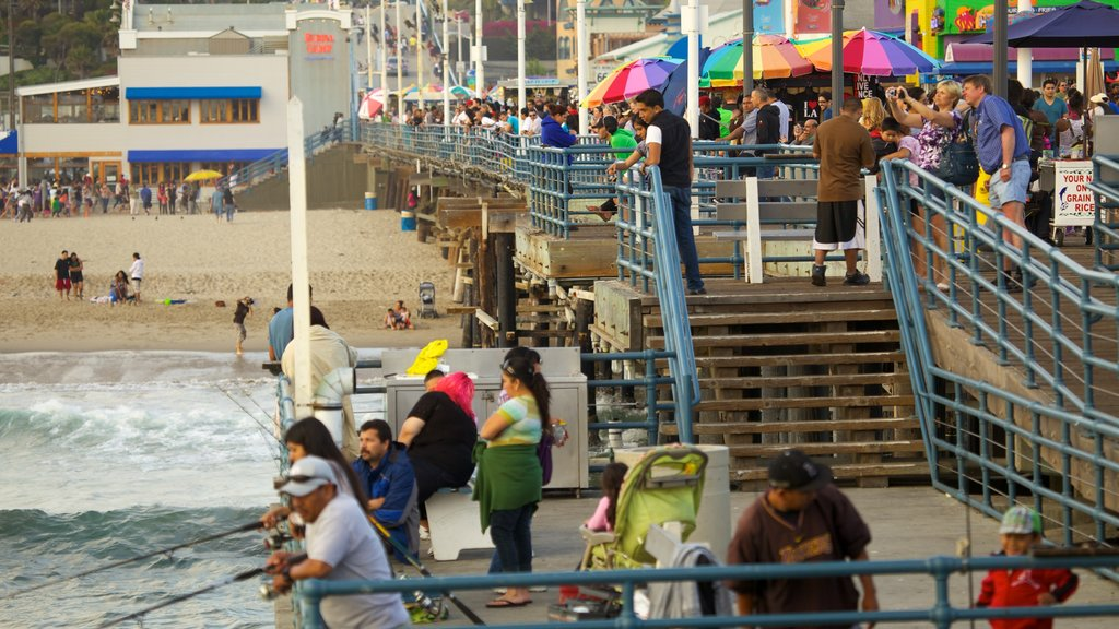 Santa Monica Pier featuring street scenes, a sandy beach and fishing