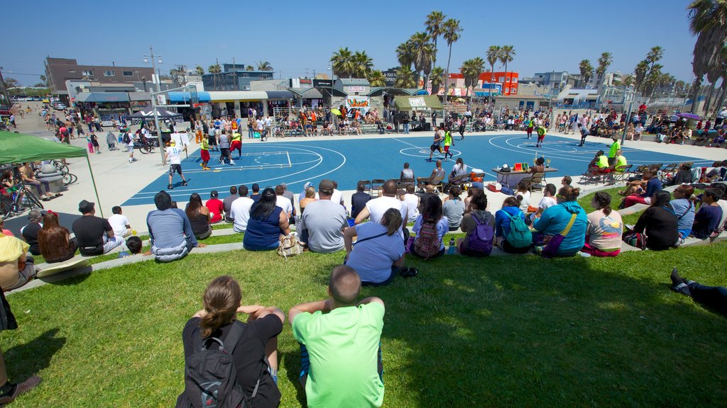 Venice Beach which includes a city and a sporting event as well as a large group of people