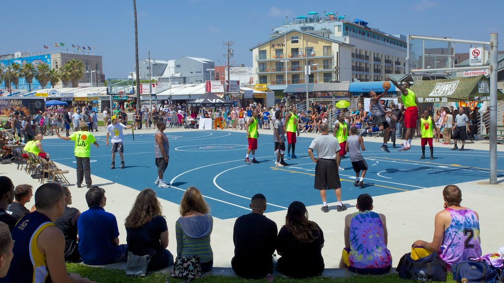 Venice Beach showing a sporting event and a city as well as a large group of people