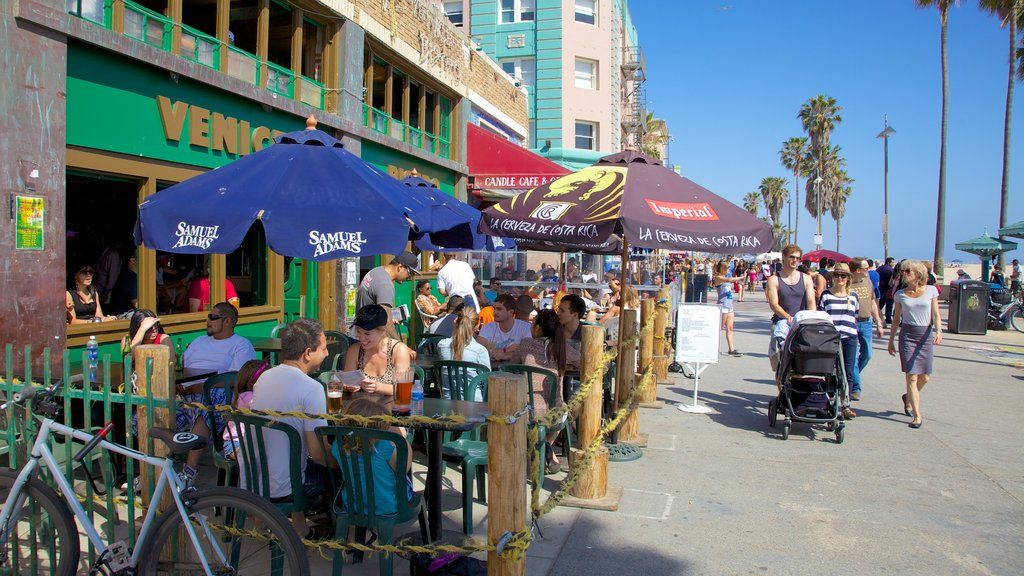 Venice Beach which includes outdoor eating, street scenes and a city