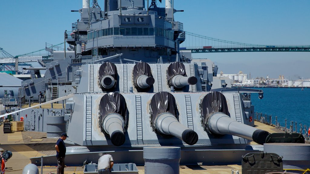 USS Iowa which includes skyline, military items and a bay or harbor