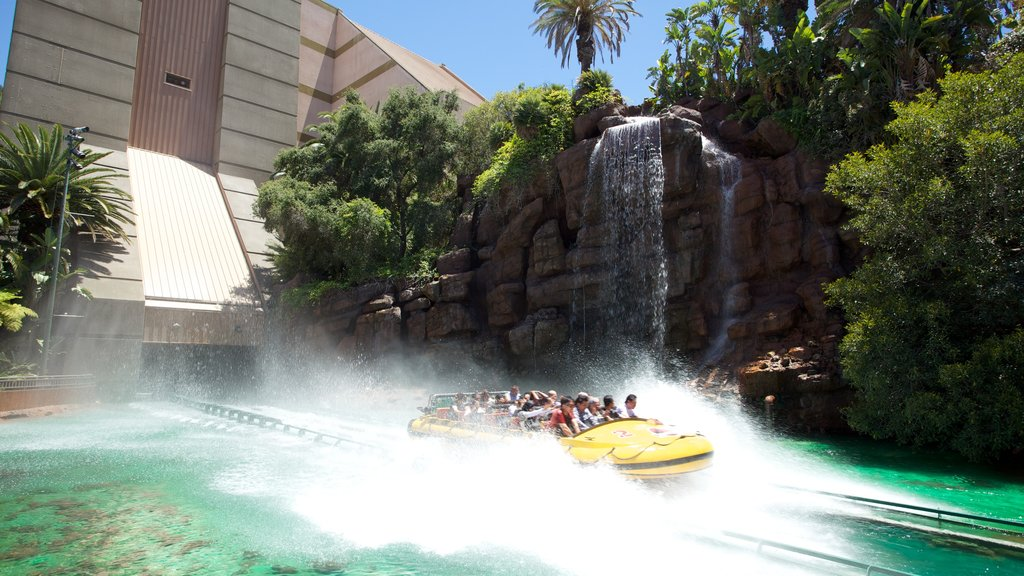 Universal Studios featuring a garden, a waterfall and rides