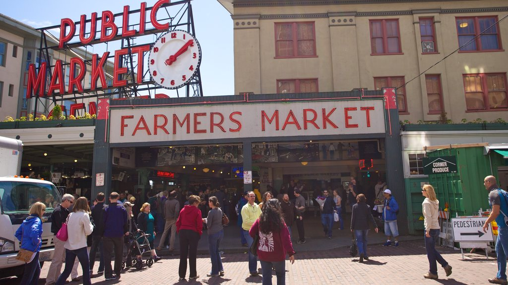 Pike Place Market featuring central business district, street scenes and signage