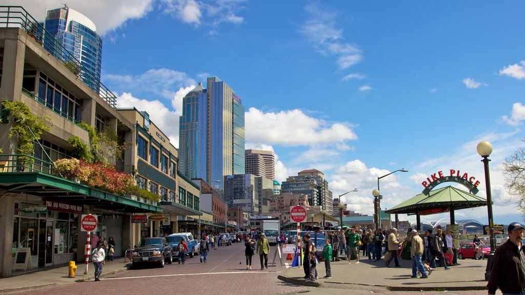 Pike Place Market showing markets, a high rise building and street scenes