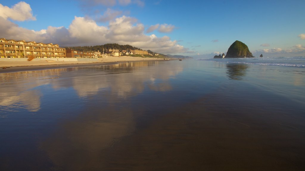 Cannon Beach featuring a beach, a coastal town and landscape views