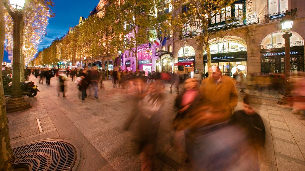 Champs Elysees featuring night scenes, nightlife and street scenes