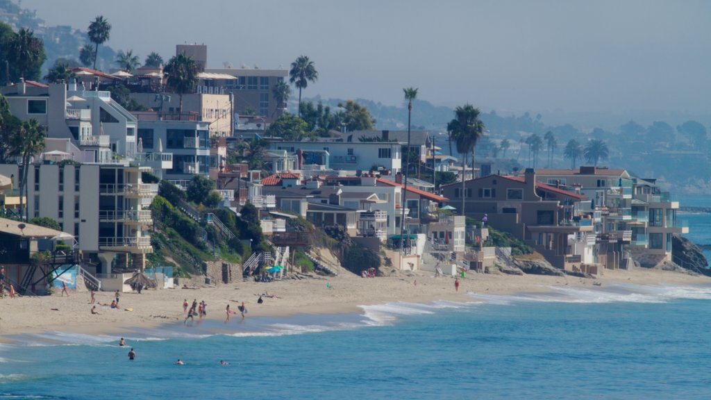 Laguna Beach showing tropical scenes, a sandy beach and swimming