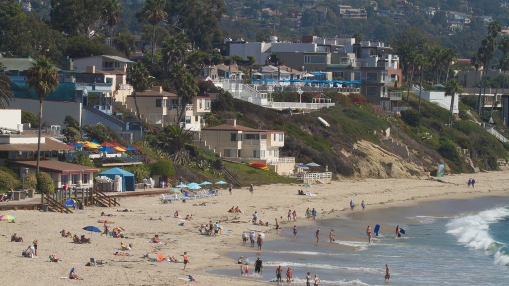 Laguna Beach showing landscape views, a sandy beach and a coastal town
