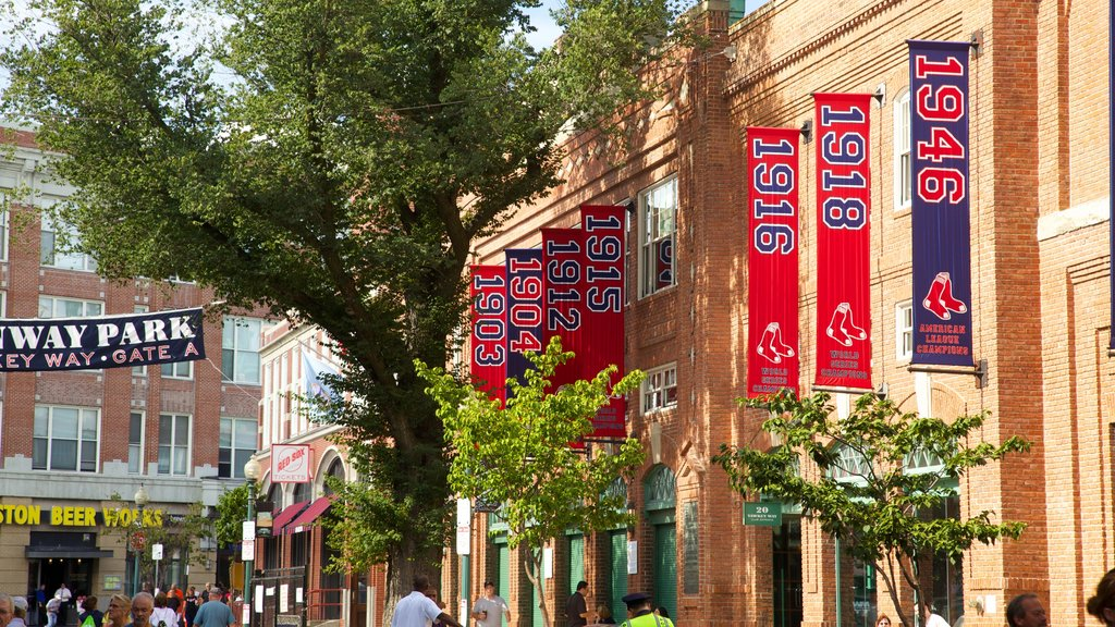 Fenway Park showing a city, street scenes and signage