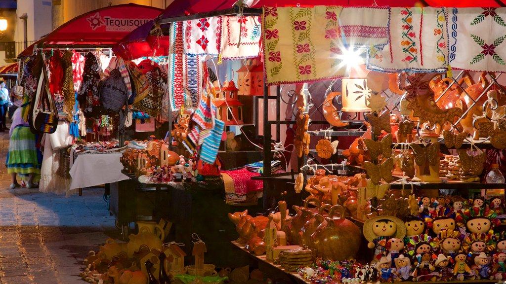 Plaza Miguel Hidalgo showing night scenes and markets