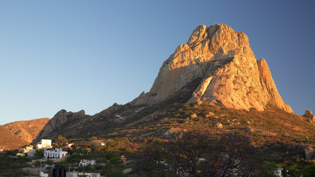 Pena de Bernal which includes tranquil scenes and mountains