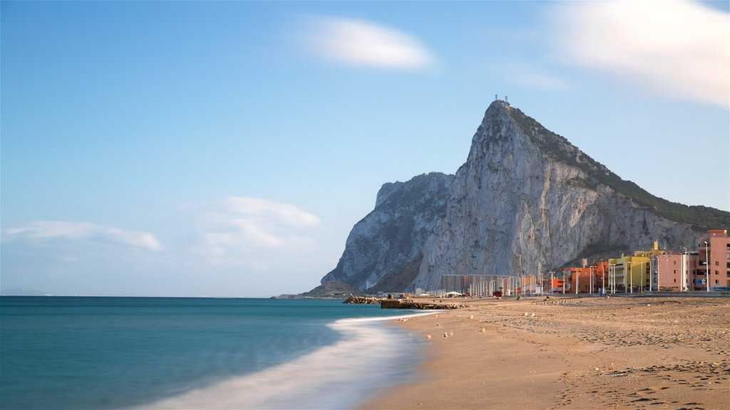 Rock of Gibraltar showing mountains, general coastal views and a beach