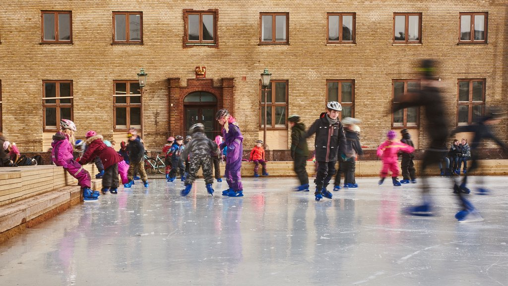 Skive which includes ice skating as well as a small group of people