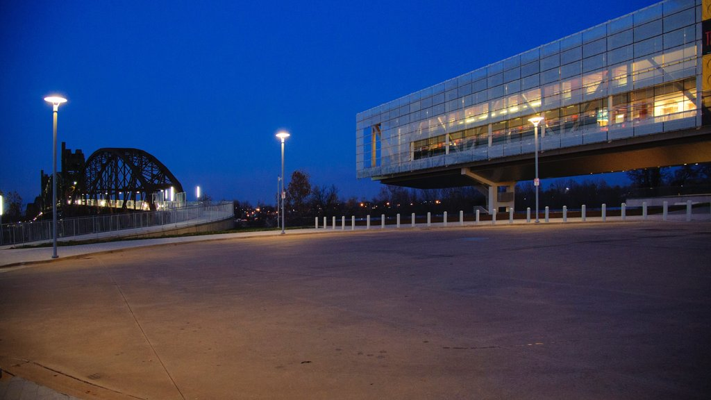 William J. Clinton Presidential Library featuring a bridge, night scenes and modern architecture