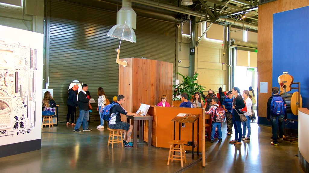 Exploratorium featuring interior views as well as a small group of people