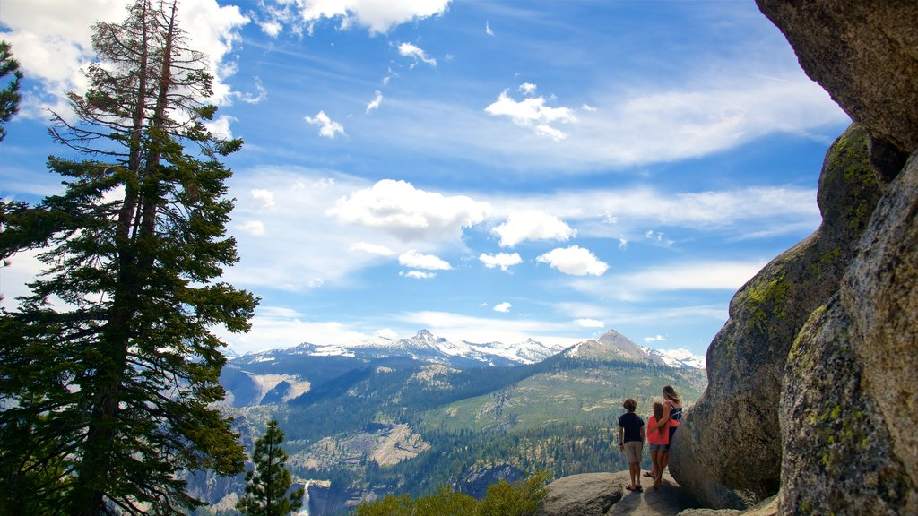 Glacier Point showing tranquil scenes as well as a small group of people
