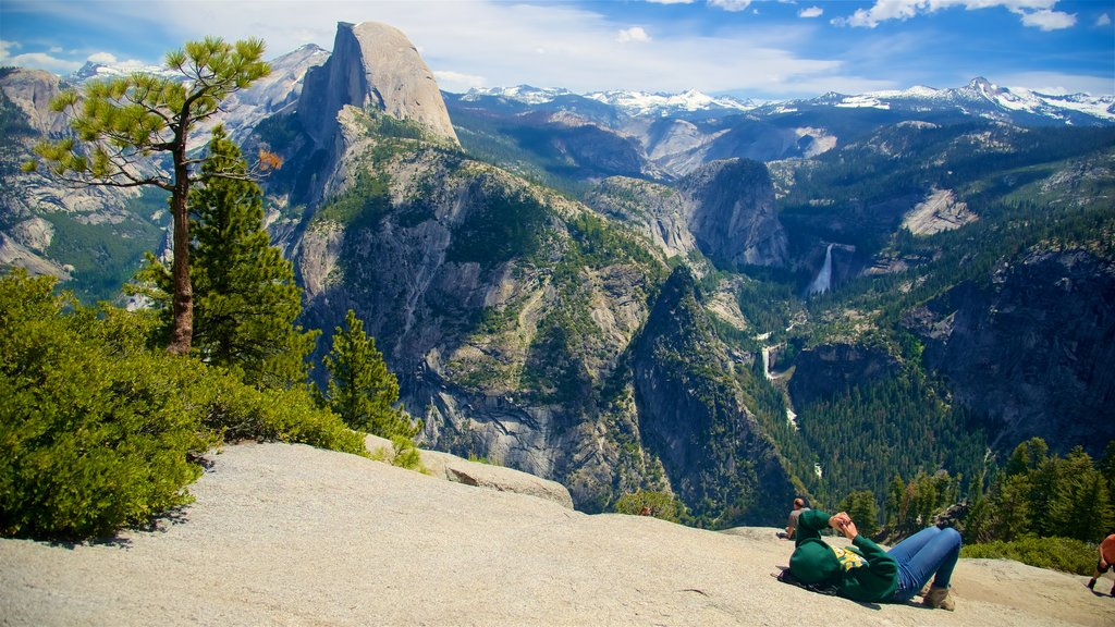 Glacier Point which includes mountains and landscape views as well as a small group of people