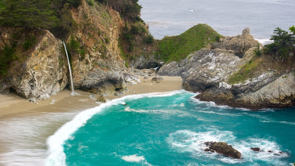 McWay Falls featuring rocky coastline, a beach and a bay or harbor