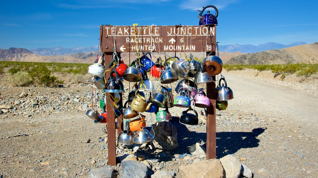 Teakettle Junction which includes desert views, outdoor art and signage