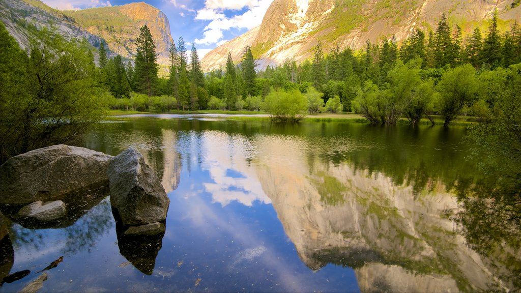 Yosemite National Park which includes mountains, tranquil scenes and a lake or waterhole
