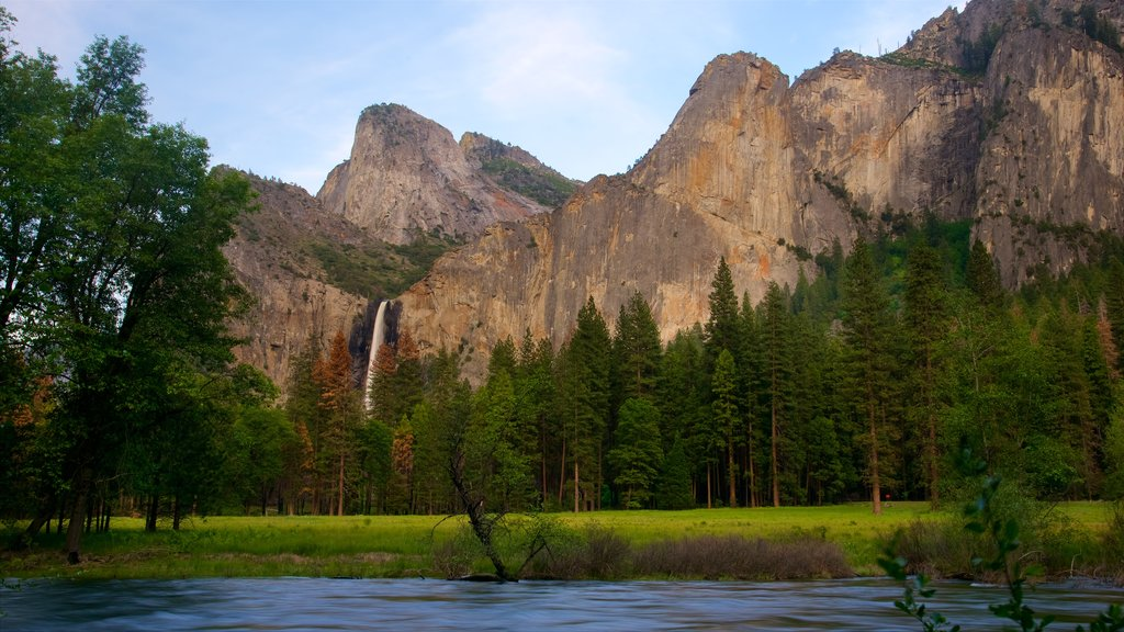 Yosemite National Park which includes mountains, a lake or waterhole and tranquil scenes