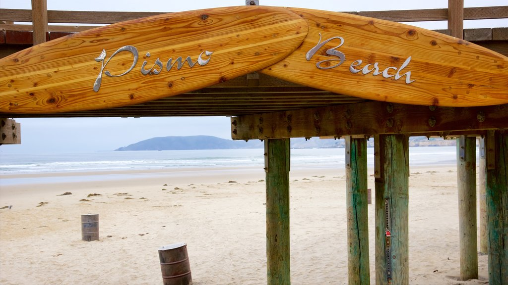 Pismo Beach featuring signage and a sandy beach