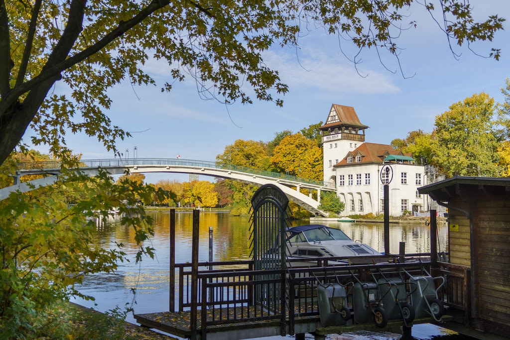 View across the water of a pier and a bridge in Berlin