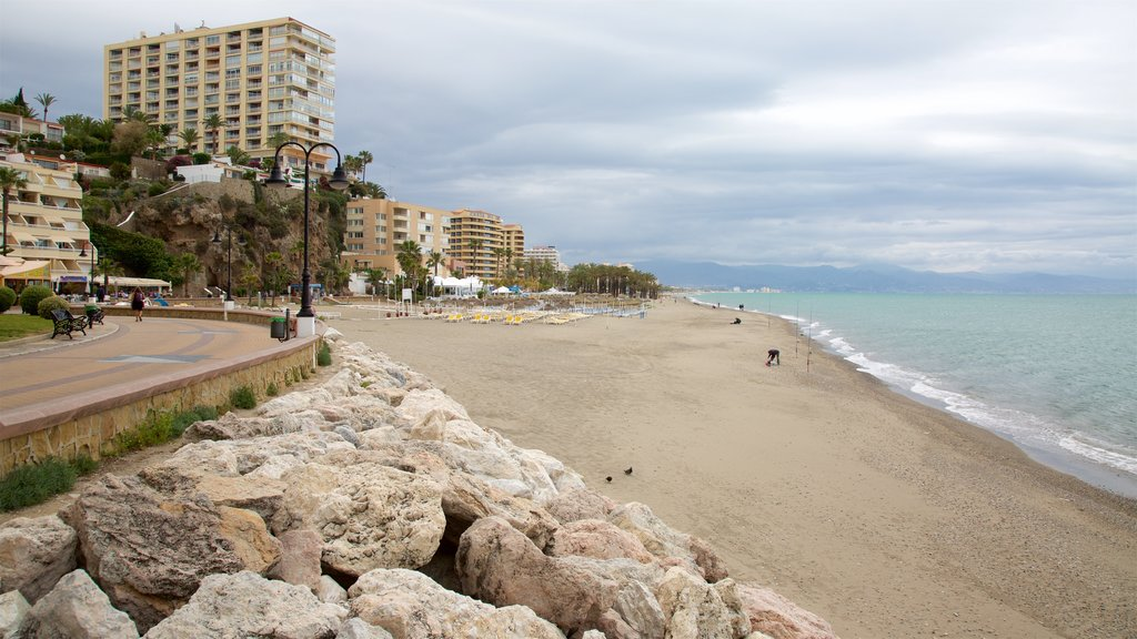 Torremolinos showing a sandy beach and a coastal town